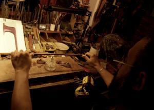 László Lakatos is bending a bow stick
