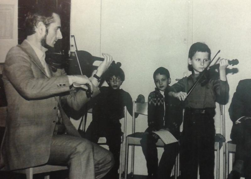 András Nagy playing violin with his father